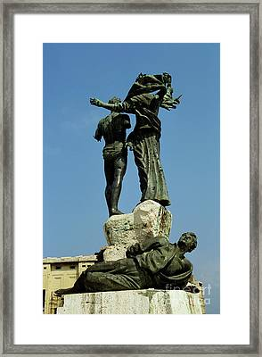 Bullet Holes Covering Statues In Martyr's Place In Beirut Framed Print by Sami Sarkis