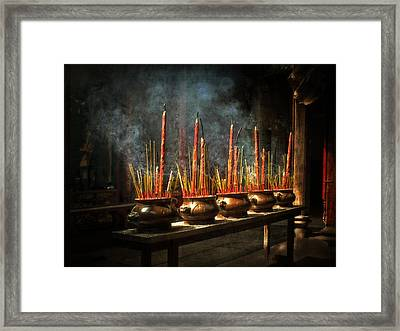 Burning Incense Framed Print