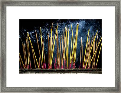 Burning Joss Sticks Framed Print by Hitendra SINKAR