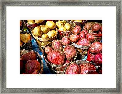 Bushels Of Potatoes At A Farm Market Framed Print by Olivier Le Queinec