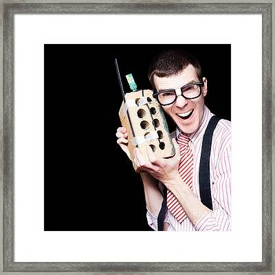 Business Geek Laughing On House Brick Phone Framed Print by Jorgo Photography - Wall Art Gallery