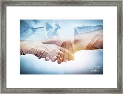 Business Handshake Over Modern Skyscrapers, Double Exposure. Framed Print