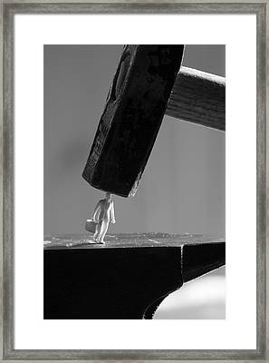 Business Man Between Hammer And Anvil Framed Print