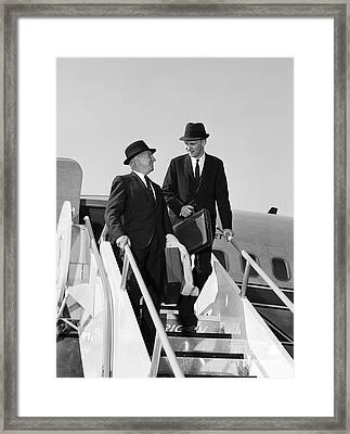 Businessmen Exiting Airplane Framed Print by H. Armstrong Roberts/ClassicStock