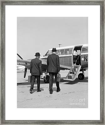 Businessmen Walking To Plane Framed Print by H. Armstrong Roberts/ClassicStock