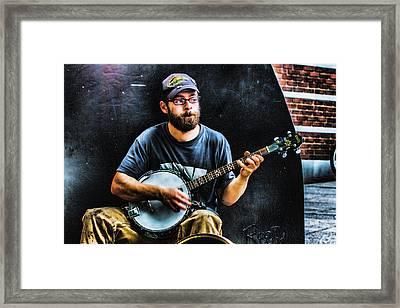 Busking With A Banjo Framed Print by John Haldane