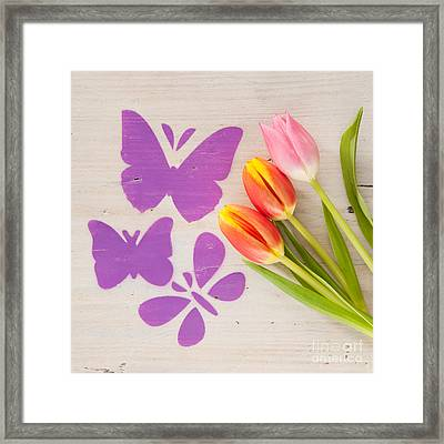 Butterflies Flying Over A Meadow Of Tulips Framed Print