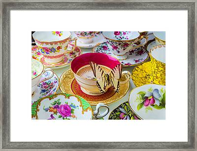 Butterfly On Red Tea Cup Framed Print