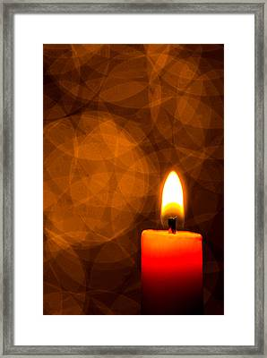 By Candle Light Framed Print