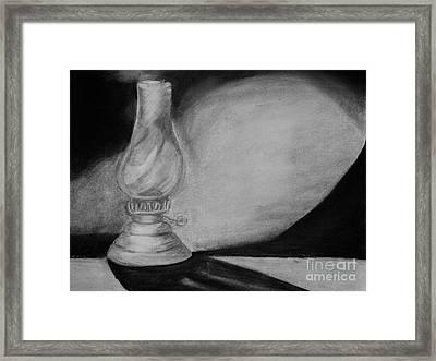 By Lamp Light Framed Print