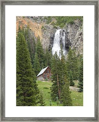 Cabin And A Waterfall Framed Print by Jeff Swan