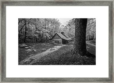 Cabin In The Cove Framed Print by Jon Glaser