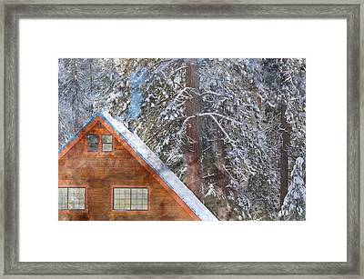 Cabin In The Snow Framed Print by Brandon Bourdages