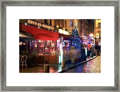 Cafe La Bucherie Framed Print by John Rizzuto