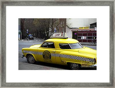 Caliente Yellow Cab Framed Print by John Rizzuto
