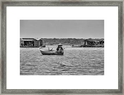 Cambodian Woman In A Boat Framed Print
