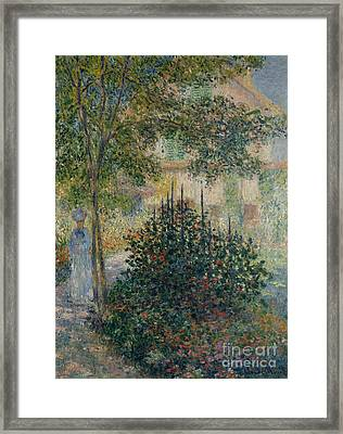 Camille Monet In The Garden At Argenteuil, 1876 Framed Print by Claude Monet