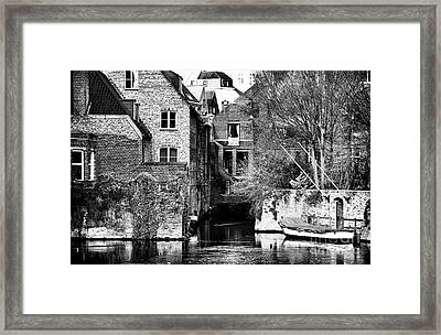 Canal Living In Bruges Framed Print by John Rizzuto