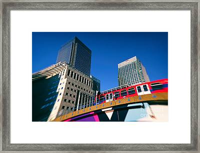 Canary Wharf Commute Framed Print by Jasna Buncic