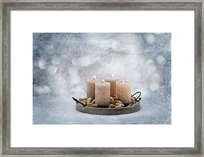 Candle In Snow Framed Print by Heike Hultsch