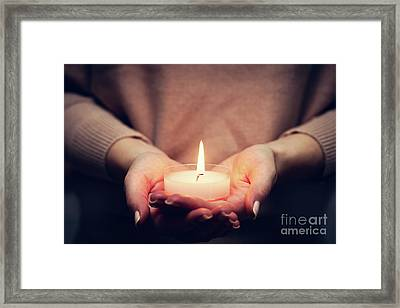 Candle Light Glowing In Woman's Hands. Praying, Faith, Religion Framed Print by Michal Bednarek