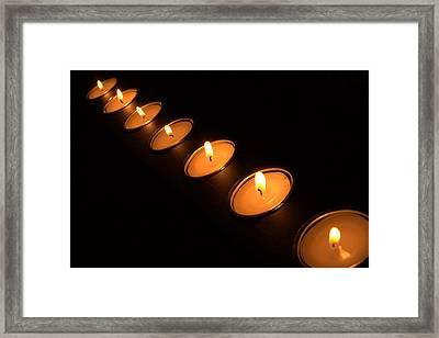 Candles In A Row Framed Print by Alexander Fedin