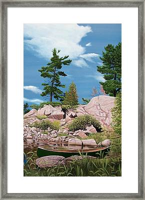 Canoe Among The Rocks Framed Print by Kenneth M  Kirsch