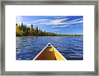 Canoe Bow On Lake Framed Print