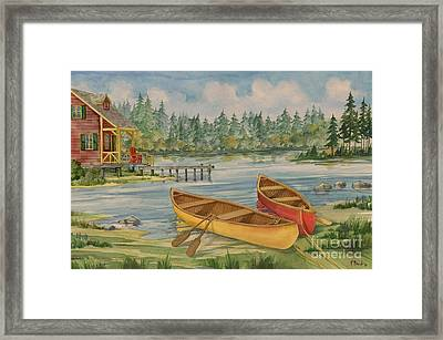 Canoe Camp With Cabin Framed Print by Paul Brent