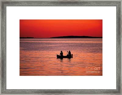 Canoe Fishing Framed Print by John Greim