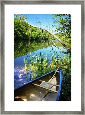 Canoe On A Mountain Lake Framed Print by Debra and Dave Vanderlaan