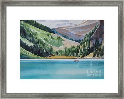 Canoeing-in-lake-louise Framed Print by Nancy Newman