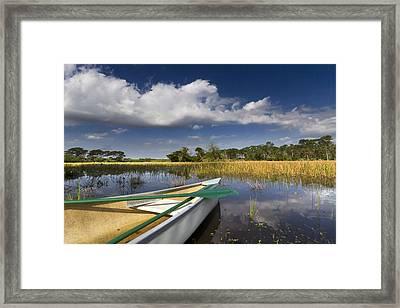 Canoeing In The Everglades Framed Print by Debra and Dave Vanderlaan