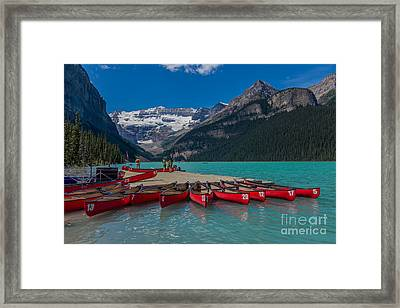 Canoes On Lake Louise Framed Print by John Roberts