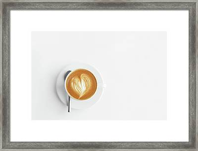 Cappuchino Or Latte Coffe In A White Cup With Heart Shaped Foam On Wooden Board Framed Print by Alim Yakubov