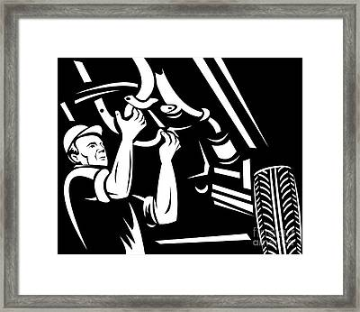 Car Mechanic Working Framed Print by Aloysius Patrimonio