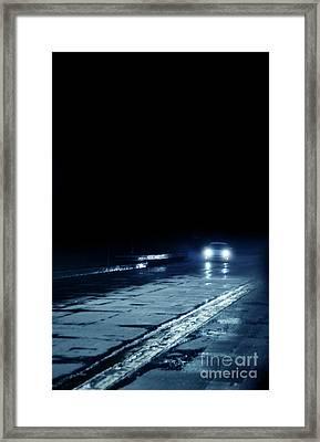Car On A Rainy Highway At Night Framed Print by Jill Battaglia