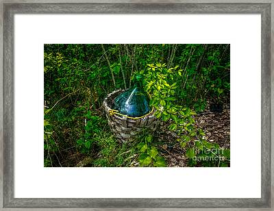 Carboy In A Basket Framed Print by Roger Monahan