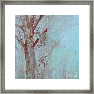 Cardinals In Trees Whilst Snowing Framed Print