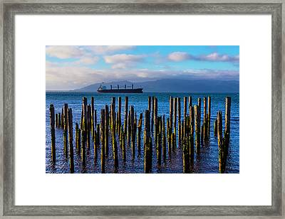 Cargo Ship And Old Pier Posts Framed Print