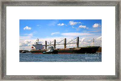 Cargo Ship And Tugboats  Framed Print by Olivier Le Queinec