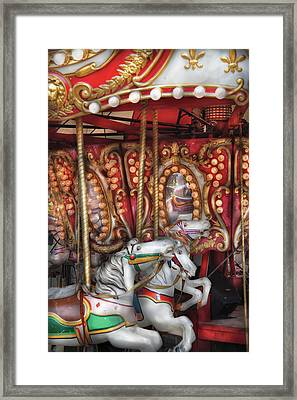 Carnival - The Carousel Framed Print by Mike Savad