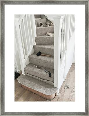 Carpet Fitting Framed Print by Tom Gowanlock