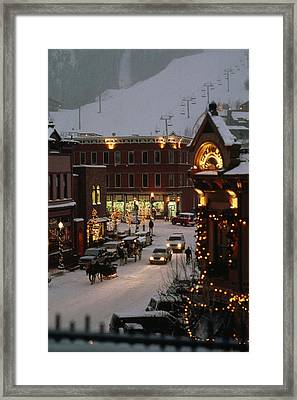 Carriage And Slded On Snowy Steets Framed Print by Paul Chesley