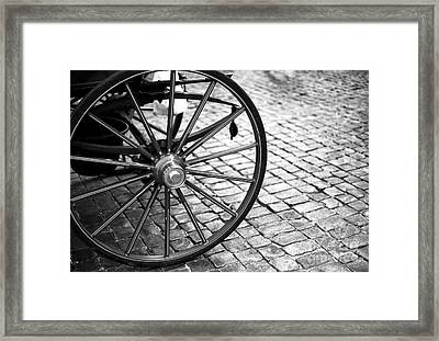 Carriage Wheel In Rome Framed Print by John Rizzuto