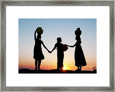 Carrying Water Framed Print by Tim Gainey