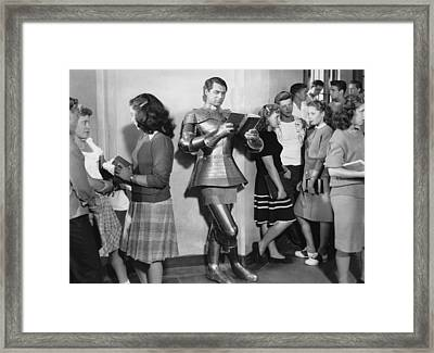 Cary Grant In Armor Framed Print by Underwood Archives