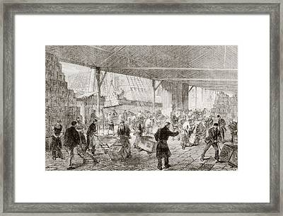 Cases Of Tea Being Unloaded From A Framed Print by Vintage Design Pics