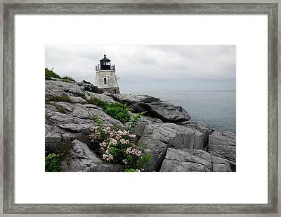 Castle Cliff Lighhouse Framed Print by Alan Lenk