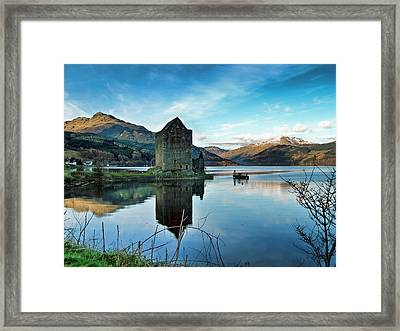Castle On The Loch Framed Print by Lynn Bolt